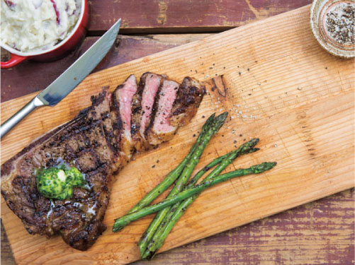 Balsamic-Marinated Steaks with Herb Butter and Grilled Asparagus